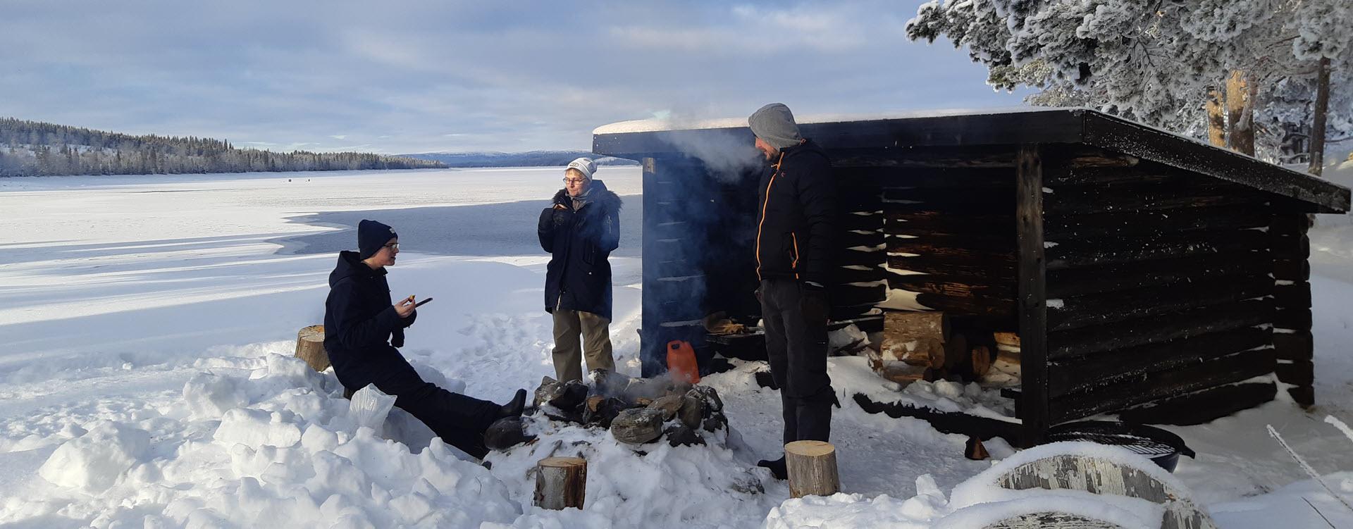 Gäddede Camping Accommodation fireplace at lake